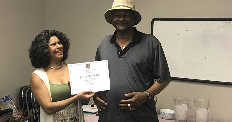 Man Awarded a Certificate