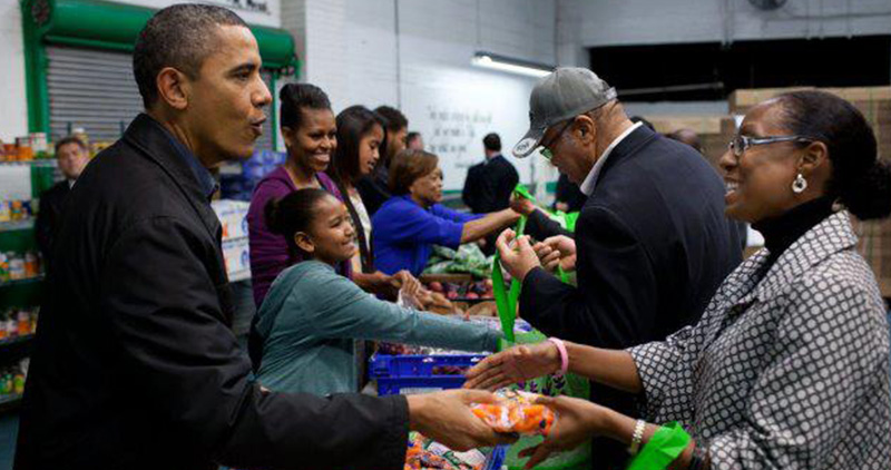 Obama Family Serving Food